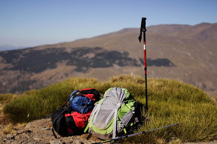 backpacking gear at the top of a mountain