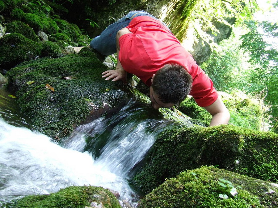 Drinking water directly from stream. Can lead to water-borne illness.