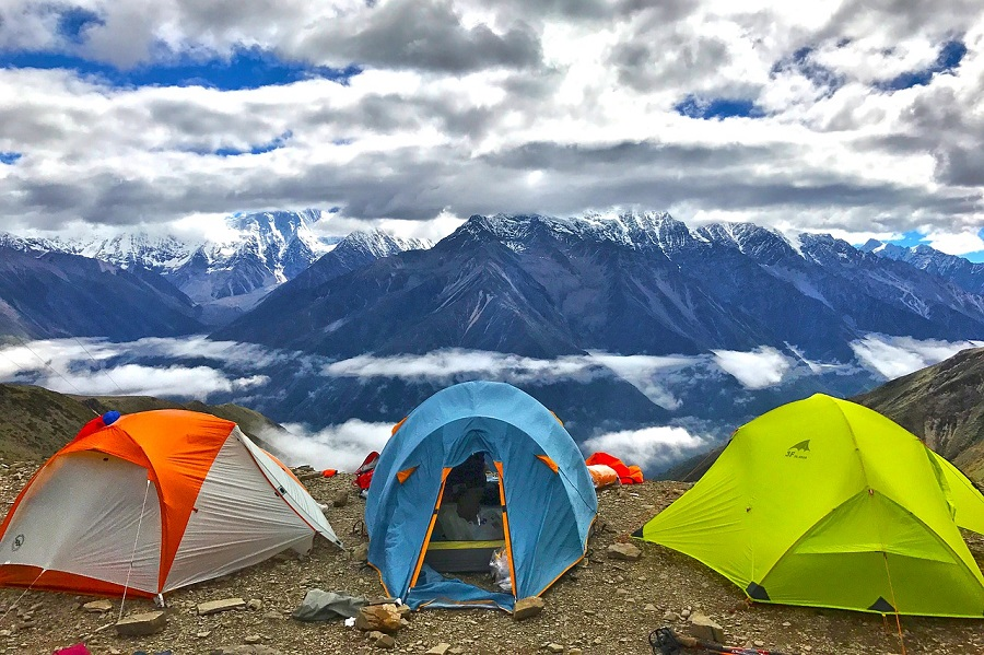 An ultralight backpacking tent weighs less but loses some comfort.