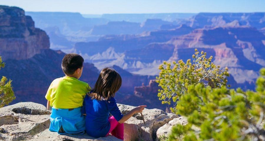 Kids resting overlooking beautiful canyon