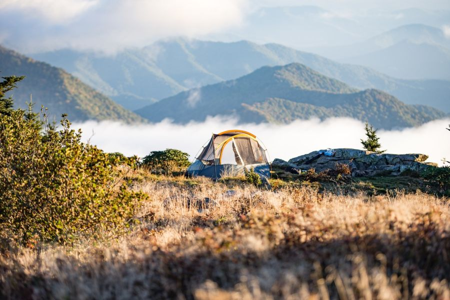 backpacking gear rentals, tent in the mountains