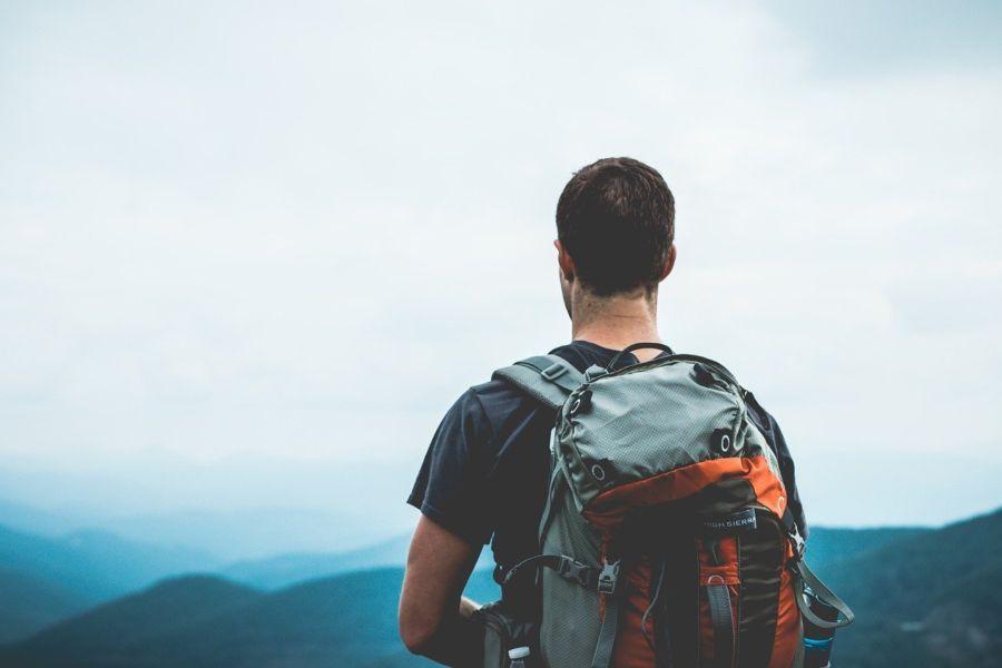 hiker wearing backpack on shoulders